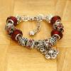 Love Eternal Jewelry Co.,LTD Piros kristályos karkötő virág medállal