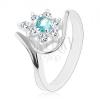 Gyűrű ezüst színben, csillogó átlátszó virág világoskék középpel, ívek