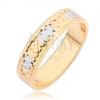 Arany színű gyűrű karöka bevágásokkal és ezüst színű részekkel