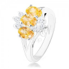 Fénylő gyűrű ezüst színben, átlátszó és sárga ovális cirkóniák