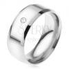 Fényes, acél gyűrű, lemetszett oldalak, átlátszó, kerek kő