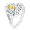 Csillogó gyűrű ezüst árnyalatban, sárga szem, átlátszó cirkóniák