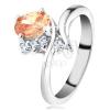 Csillogó gyűrű ívelt szárakkal, narancssárga ovális cirkónia, átlátszó kövek