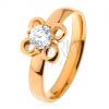Gyűrű sebészeti acélból arany árnyalatban, virág átlátszó cirkóniával