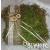 Gyűrűpárna mohából csipkével, szalaggal és fa rátéttel díszítve