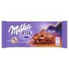 Milka Triple á la Caramel alpesi tejcsokoládé tejes krémmel, töltelékkel és mandula darabokkal 90 g