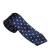 Sötétkék, fehér és narancssárga virágokkal díszített nyakkendő